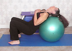 Swiss ball hip extension, with head on ball (harder exercise - start/finish position