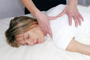 Woman receiving Bowen Therapy
