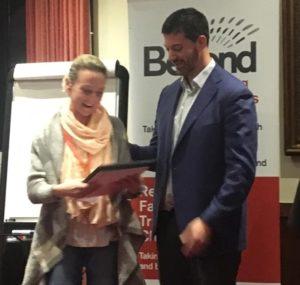Kelly Swain receiving her NLP Practitioner certificate