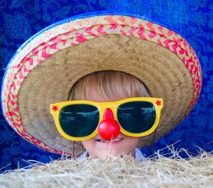 child with hat and sunglasses