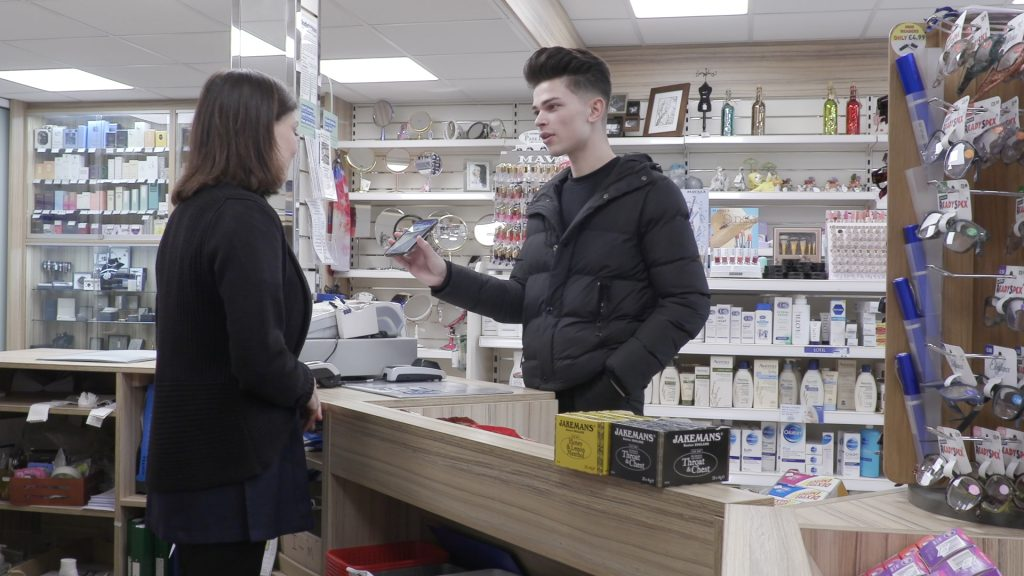 man using EC-Card app in a pharmacy
