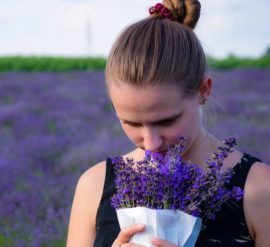 What it's like to live without a sense of smell? woman smelling lavendar bouqet